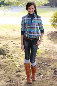 Plaid shirt layered over turtleneck and boots over bootsocks.