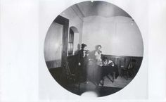 Hill daughters in the Servants' Hall/sitting room of the James J. Hill House, 1891. The door to the hallway and the faux window is to the left. Photo taken looking east.