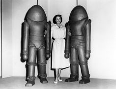 """parkcircus: """" Joan Taylor seems relaxed despite having a hostile alien on each arm in this publicity shot from 50s sci-fi classic Earth vs. the Flying Saucers. Available soon for bookings on digital. """""""
