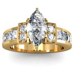 Marquise Cut Channel Set Diamond Engagement Ring - Here comes a flawless 14K Yellow Gold Marquise Cut Channel Set Diamond Engagement Ring placed in a Prong & Channel setting featuring a White Marquise Cut center stone with 14 White Round cut accent stones. The Marquise Channel Set engagement ring has a VS2 in clarity with an H in color & the total gem weight is equal to 1.80 carats. All of the diamonds are 100% natural. #unusualengagementrings