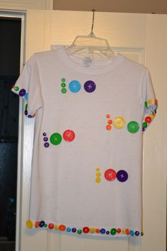 T-Shirt I made for my son's 100th day of school.  YES...I sewed on 100 buttons!