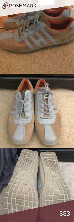Unique sneakers. Very cute light brown suede sneakers with light blue stripes on each sides of the shoe.  Lightly piped with orange around the ankle of the shoe.  Lightly used.  Not sure if men's or women's but it's a size 39, but I really think they are women's! Ecco Shoes Sneakers
