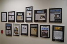 How to display newspaper or magazine articles with frames - we love how this company used a straight line down the middle and went off center - give more visual interest to the whole display