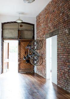 wood floor exposed brick wall