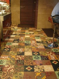 patchwork of cement encaustic tiles at a restaurant.