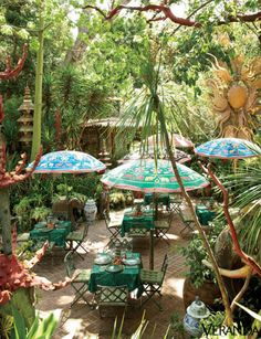 In the Wilkinson/Duquette universe, there are certain rules for entertaining. Foremost, no white napkins allowed. Using a vast collection of china, flatware and figurines inherited from the Duquettes, Wilkinson adds his own newer pieces to create fantastically colored landscapes for the table. Coral red mixes happily with jade green, cerulean blue and, of course, gold—lots and lots of gold.<br /><br /><em><strong>Small tables make a large party more intimate.</strong> </em>