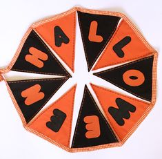 """Festive """"Happy Halloween"""" decoration bunting with orange and black flags to last for years. Ideal for decoration during Halloween or a season's gift."""
