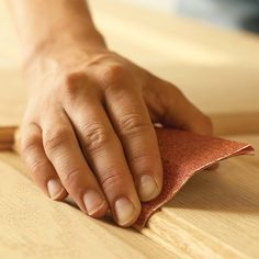 Hand-Sand the Curves - 20 Wood Finishing Tips: http://www.familyhandyman.com/woodworking/staining-wood/wood-finishing-tips