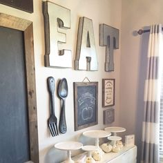 Gallery Wall Dining Room Kitchen. Great mix of elements for this gallery wall. I love the chalkboard and the fork and spoon hanging the wall!