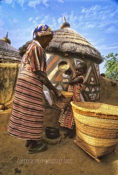 Africa | Young helping the old.  Gurunsi village, Burkina Faso | ©Rosemary Sheel