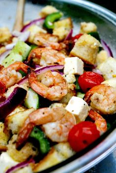 This Greek Shrimp Panzanella Bread Salad features grilled marinated shrimp and tomatoes, crusty bread, feta cheese, and tons of garden fresh vegetables all tossed in a bold and flavorful homemade Greek vinaigrette. Shrimp Salad Recipes, Salad Recipes Video, Healthy Salad Recipes, Seafood Recipes, Healthy Snacks, Cooking Recipes, Seafood Dishes, Marinated Shrimp, Baked Shrimp