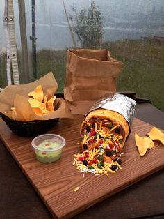 Burrito (red velvet) groom's cake with fondant corn chips, beans, cheese, peppers, rice & buttercream guacamole!!