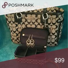 """Coach black bag/Jewlery box nice quality set! Gently used for a couple months. Purchased @ Coach. Fabric bag has larger C's inside standard 2 pouches one side/zipper pocket on other. 10"""" straps. 10"""" top zipper opens completely to expand. Outside zipper down pockets. Zippered jewelry box smaller C's than bag/fits inside FLAWS: Jewelry box/small spot. BAG: Inside large outside pocket small hole & thin 2"""" scrape pic 5. Missing 2 silver rivets from 2 straps pic 3. Pet/ smoking home Memorial Day…"""