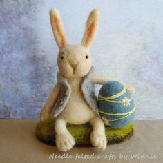 Easter bunny and his blue Easter egg needle by FunFeltByWinnie