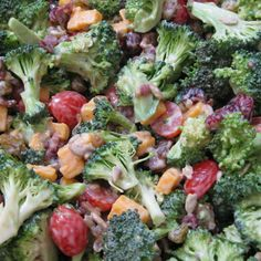 1	head broccoli 6 to 8	slices cooked bacon, crumbled ½	cup chopped red onion ½	cup raisins, optional 8	ounces sharp Cheddar, cut into very small chunks 1	cup mayonnaise 2	tablespoons white vinegar ¼	cup sugar ½	cup halved cherry tomatoes Salt and freshly ground black pepper