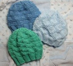 These Textured Baby Hats are too cute not to knit.  Included in this handy free knitting pattern are three variations of the same hat.  Once you create a ribbed edge, you can make a hat with a Little Check pattern, a King Charles Brocade pattern or the English Diamond Block pattern. Complete instructions for preemie and newborn sizes are all included.