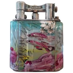 Alfred Dunhill 'Aquarium' Lighter | From a unique collection of antique and modern tobacco accessories at https://www.1stdibs.com/furniture/more-furniture-collectibles/tobacco-accessories/