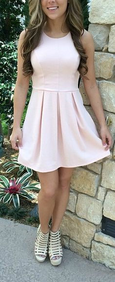 Our Meagan Dress has a flawless fit. Essential dress with gorgeous bow in the back.