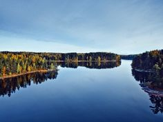 """The forested landscape is dotted with patches of water so numerous they have earned Finland the nickname """"the land of the thousand lakes""""."""