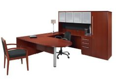 """U Shaped Desk with Hutch by Rudnick by Rudnick. $3299.00. U Shaped Desks Rudnick Contemporary Collection U Shaped Desk with Hutch is constructed of hardwood solids and veneers in a beautiful Cherry or Mahogany finish. Features include: * Fluted edge * Box / box / file locking pedestal * Hutch with tack board 4 glass doors * Wardrobe with 3 shelves and wardrobe bar Main Desk measures 72""""W x 36""""D x 29""""H. Bridge measures 48""""W x 24""""D x 29""""H. Credenza measures 72""""W x 20"""" x 29""""D. Hutc..."""
