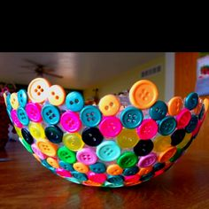 This is a great bowl!! Glue the buttons on top of an inflated ballon, let dry then pop the ballon!