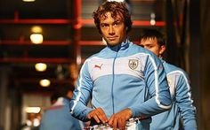 Too hard to pick only one, these guys just look good in their celeste blue. Diego Lugano and a peak at Fernando Muslera.