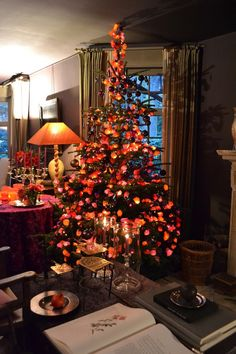 Each light bulb is wrapped in silk paper to create this special glow!! The 3rd tree is located in the living room of the main house of Belgian designer Walda Pairon