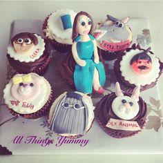 "A super customised set of cupcakes for someone who's fondly referred to as ""cousin it"" from the Adams family!! #customisedcupcakes #cupcakes #customised #cousinit #adamsfamily #rabbit #bunny #donkey #shrek #rajpalyadav #bhoolbhulaiya #teddy #glasshots #girl #bluedress #slitdress #atyummy #fondantfigurine #delhicakery #boywithglasses #fondant #sugarart #cakeart #cakeartist"