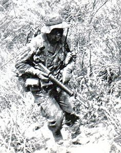 A recon Marine runs through the jungle, 1970.