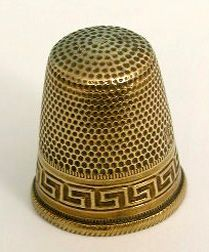 unusual pattern on this thimble - looks almost Egyptian.