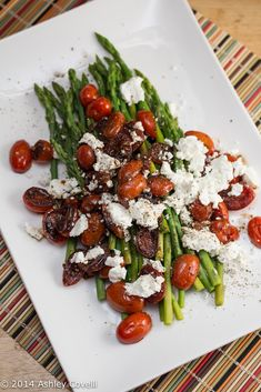 Asparagus with Balsamic Grape Tomatoes and Goat Cheese this simple and colorful side dish is the perfect addition to any springtime meal.Plus, any time I can smother veggies in goat cheese, I'm ...