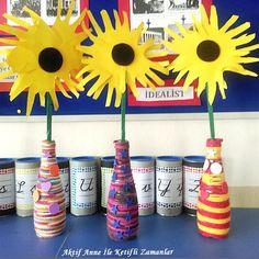 Elimizdeki ipli değerlendirdiğimiz en son etkinliğimiz.     Bu sefer cam şişeye ipimizi doladık vazo yaptık süsümüzü ve çiçeğimizi de...