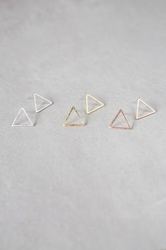 Simple triangle outline earrings with sterling silver backing. http://oopsinspired.com/