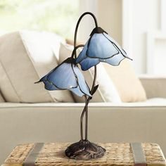 Lovely blue lilies in a Blue Bell-hue (Dale Tiffany Poelking Blue Lily Glass 2-Light Desk Lamp via Lamps Plus)