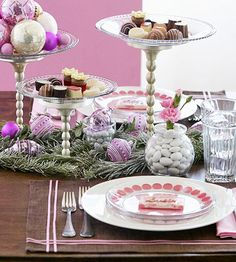 Just for Dessert  Dainty confections are the inspiration behind this whimsical table setting, from chocolate-brown place mats to sweet pink dots on the plates. For the centerpiece, hard-to-resist dessert pedestals are really metal candlesticks topped with clear glass plates. Fill them with chocolates, candies, cookies, or ornaments to enhance the playful mood.