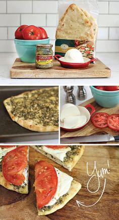 Naan with pesto, mozzarella, and tomato