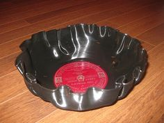 DIY - How to melt records in the oven and turn them into bowls.  Pictures and tips to making great looking bowls from old records.  200 degrees, 5 minutes, craft, easy, glass bowl, make, make a bowl, melt, melt records in oven, melting records, project, sag, salvation army, shape, touch