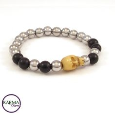 """Antique hand carved skull bead from Tibet made of Yak bone.   This badass bracelet is made with big Hematite and Onyx beads (8mm/0.314""""). For men only? This skull bracelet suits the tough and independant women just as easy as the biker kinda guys. One-of-a-kind"""