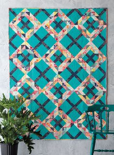 This trendy design is based on the traditional Ocean Waves quilt block. A sea-blue background grid gives it an updated look. This quilt is fat quarter friendly.