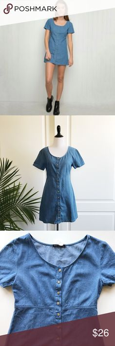 """Brandy Melville Button Down Chambray Dress Brandy Melville Scoop Neck Button Down Chambray Dress *One size (would fit S-M. Therefore listed as small) Underarm to underarm : 18"""" flat / Waist : 15"""" flat / Length : 30.5"""" *Short sleeves / Scoop neckline / Button downs   *100% cotton - machine wash *New with tags *No trade Brandy Melville Dresses"""