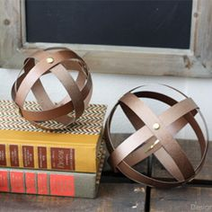 How-to create chic yet cheap Industrial Spheres using cereal boxes and spray paint!