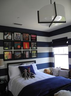 Like the album covers in frames behind the bed, could do that with any poster/picture Hunter likes!