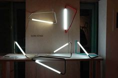 001 A light fixture made of a bended metal rod with LED on Behance