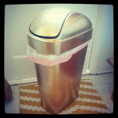 Craft alert: I spray painted my old ugly black plastic trash can gold... and now it's fabulous.