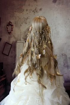 Long blond hair with decorative hair jewelry.