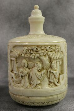 Very unusual large round ivory carved snuff bottle