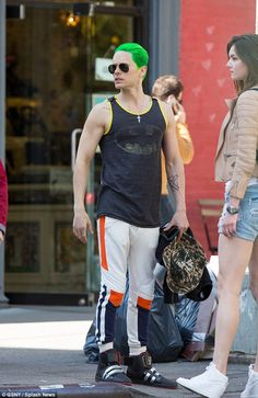 What would The Joker say? Jared Leto wears a Batman vest top despite playing his arch enemy in Suicide Squad
