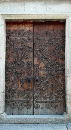 Door with swirled hinges
