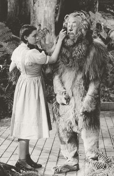 Judy Garland as Dorothy and Bert Lahr as Cowardly Lion