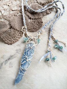 Raw, natural, un-drilled Blue Kyanite, braided and knotted with silk & organic cotton, highlighted with Apatite crystals. One-of-a-kind crystal healing amulet